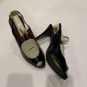 Black patent open toe sling back. Worn once.